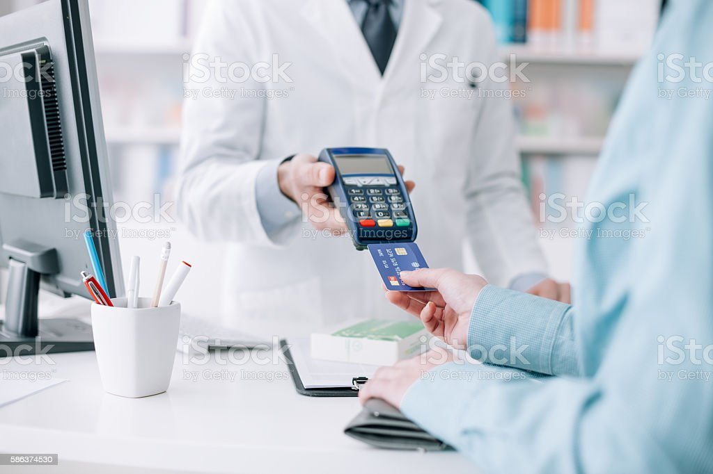 Woman purchasing medical products stock photo