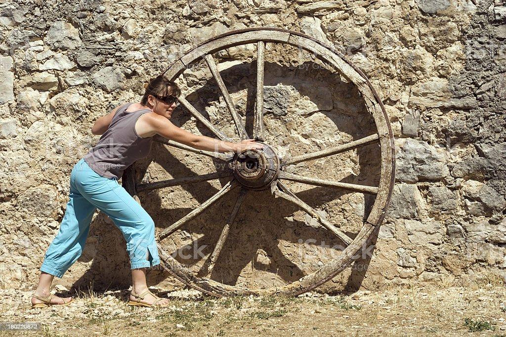 Woman  pushed rotate wheel royalty-free stock photo