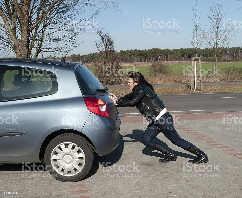 woman pushes her car stock photo