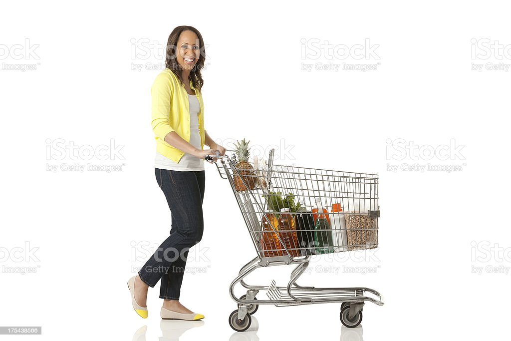 Woman pushing a shopping cart stock photo