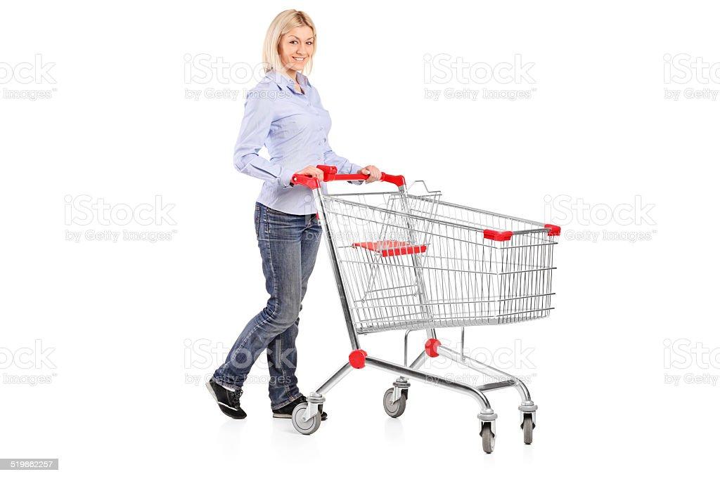 Woman pushing a shopping trolley stock photo
