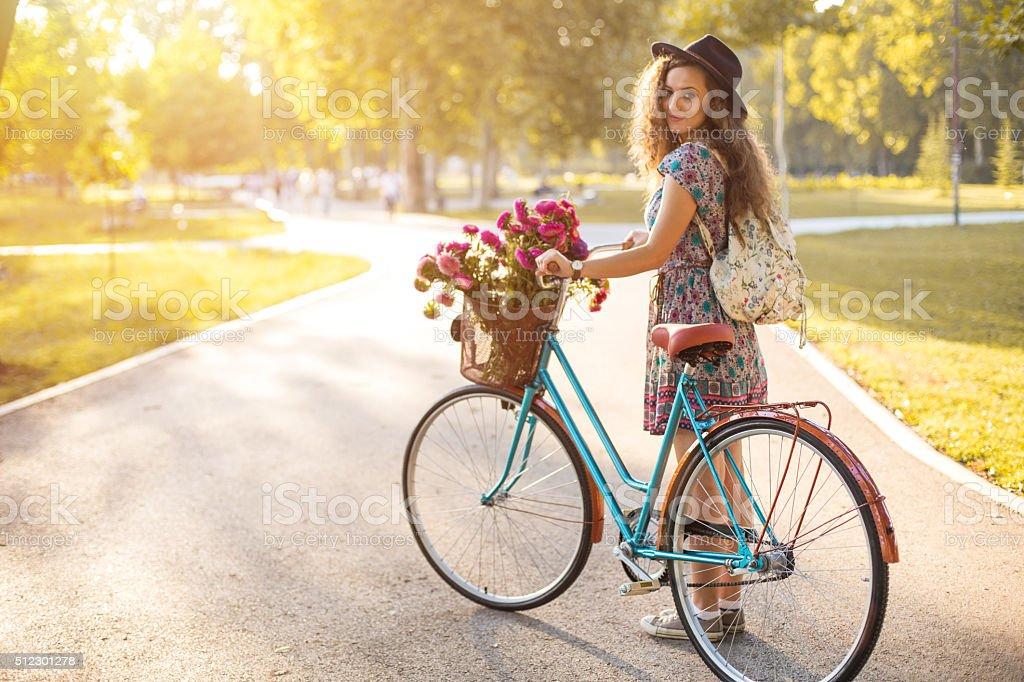 Woman pushing bicycle stock photo
