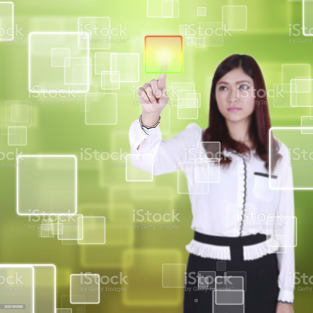 woman pushing button on a touch screen stock photo
