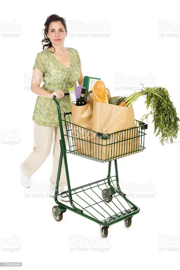 Woman Pushing Grocery Cart royalty-free stock photo