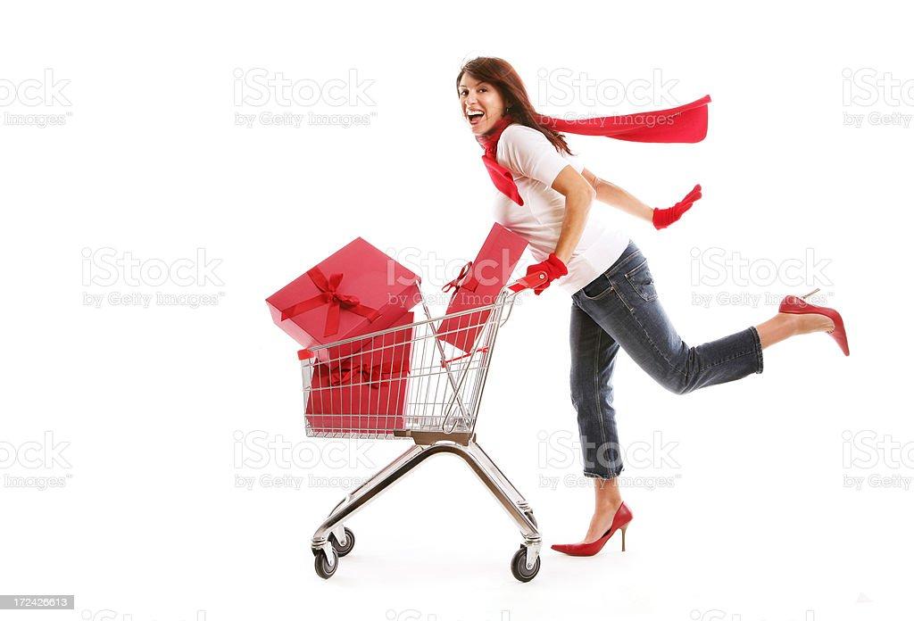 Woman Pushing Shopping Cart Containing presents stock photo