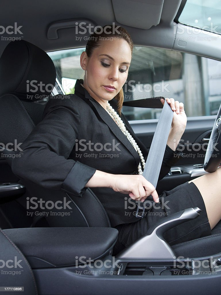 woman puting safety belt on stock photo