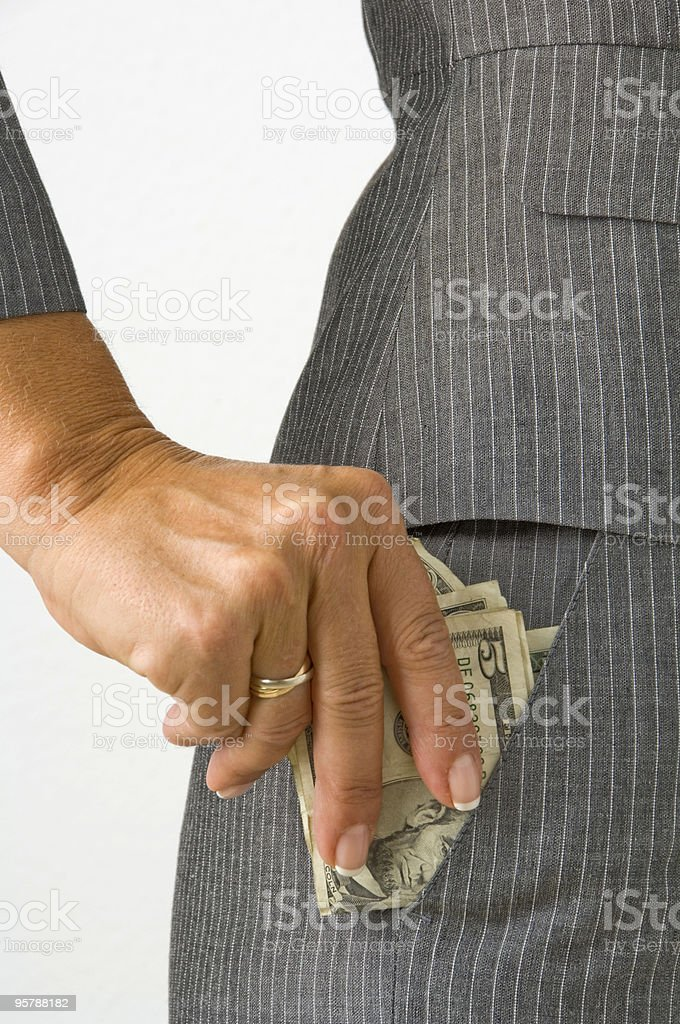 Woman puting the money in her pocket royalty-free stock photo