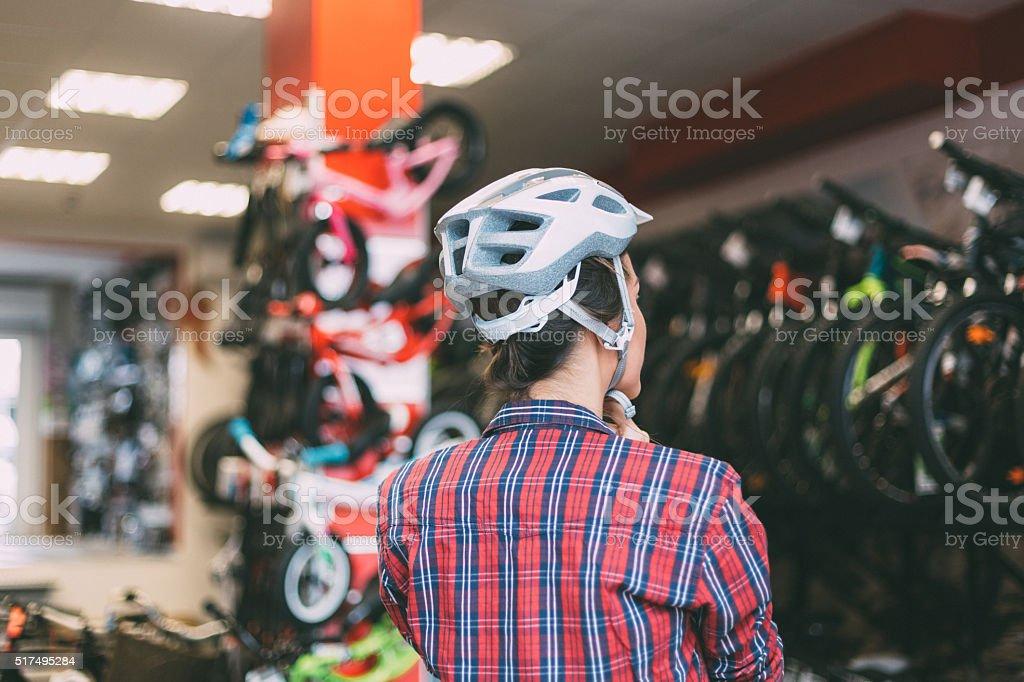 Woman Putting A Helmet stock photo