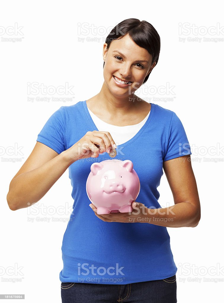Woman Putting Coin Into Piggy Bank - Isolated royalty-free stock photo