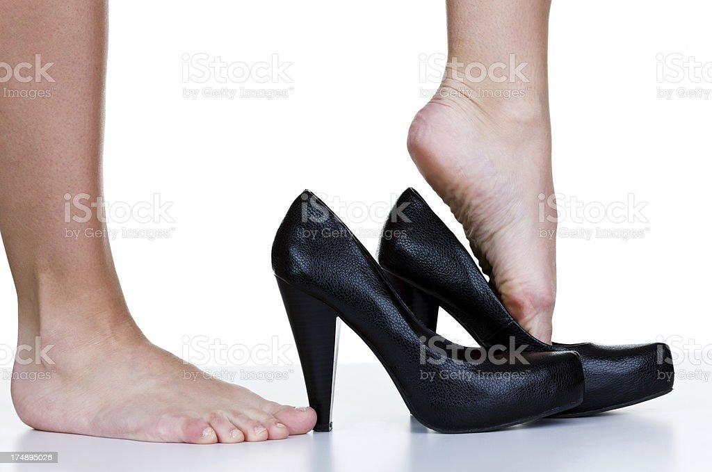 Woman putting on dress shoes royalty-free stock photo