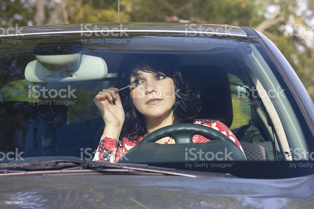 Woman Putting On Makeup royalty-free stock photo