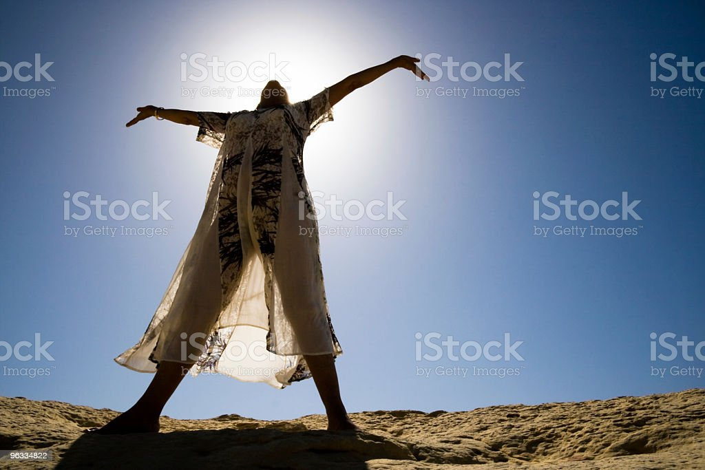 Woman raising her arms royalty-free stock photo