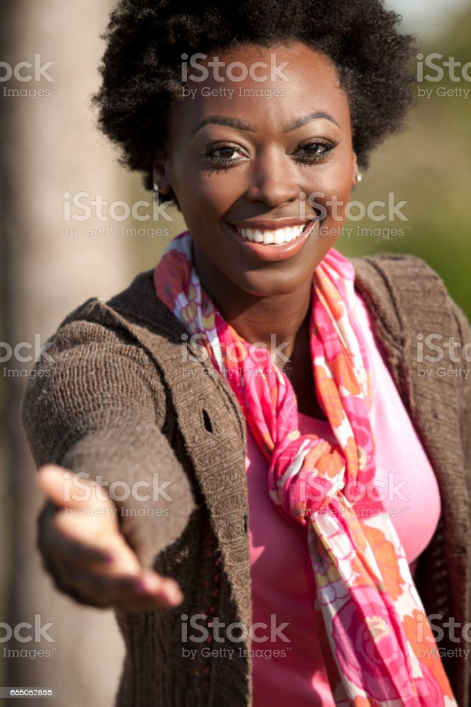 Woman reaches hands out to embrace nature. stock photo