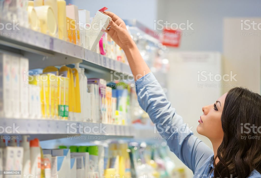 Woman reaching for beauty products stock photo