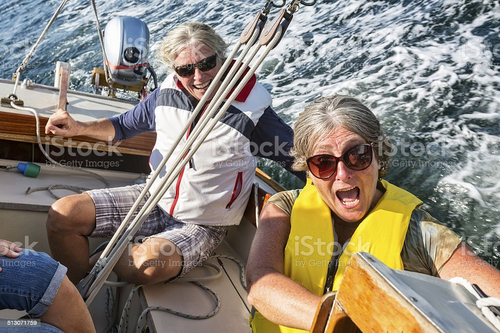 Woman Reacts as the Sailboat Leans Due to Wind stock photo