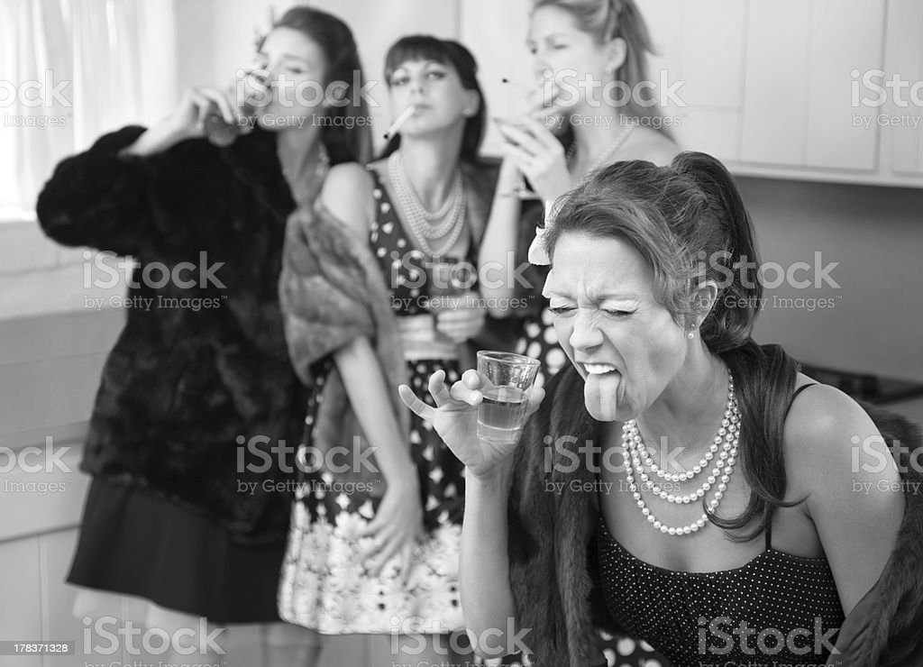Woman Reacts to a Strong Drink royalty-free stock photo
