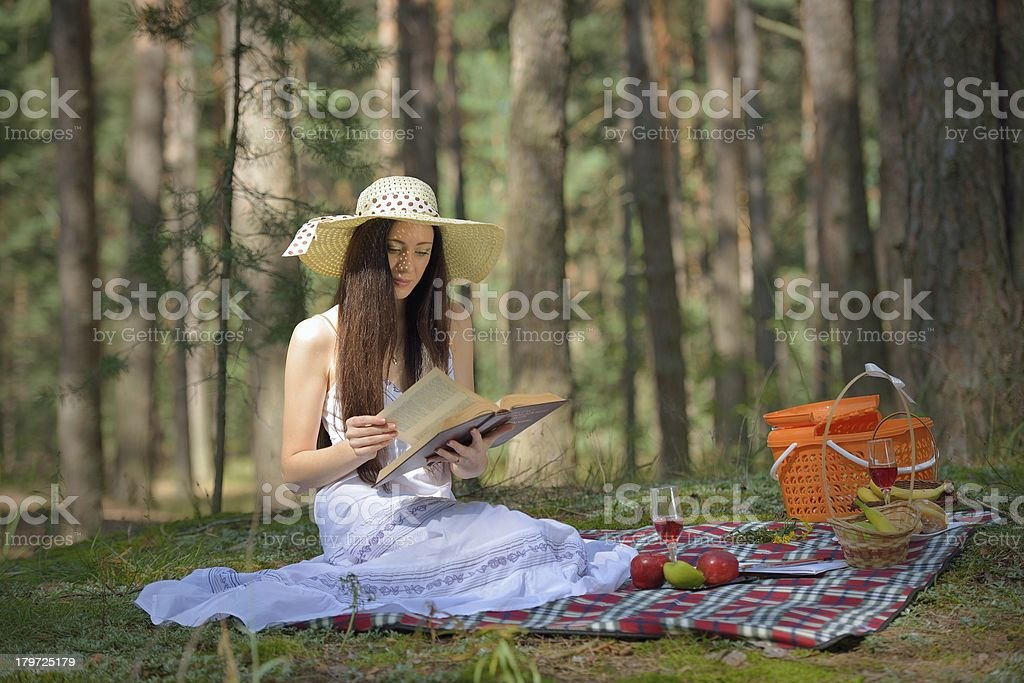 Woman Read Book And Enjoying Outdoor Picnic royalty-free stock photo