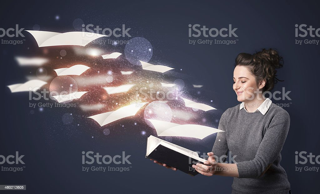 A woman reading a book allowing her imagination to take over stock photo