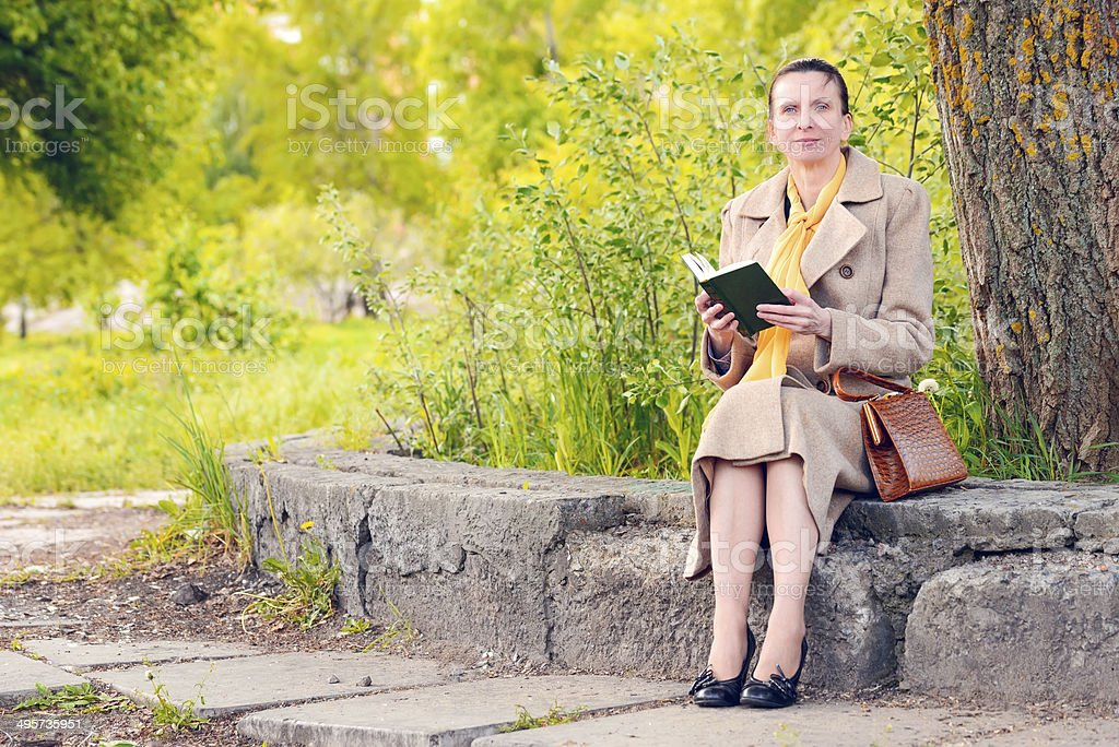 Woman Reading a Book in the Park royalty-free stock photo