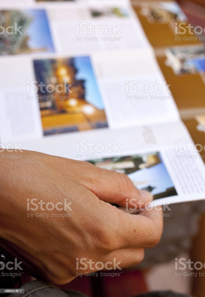 Woman reading a brochure stock photo