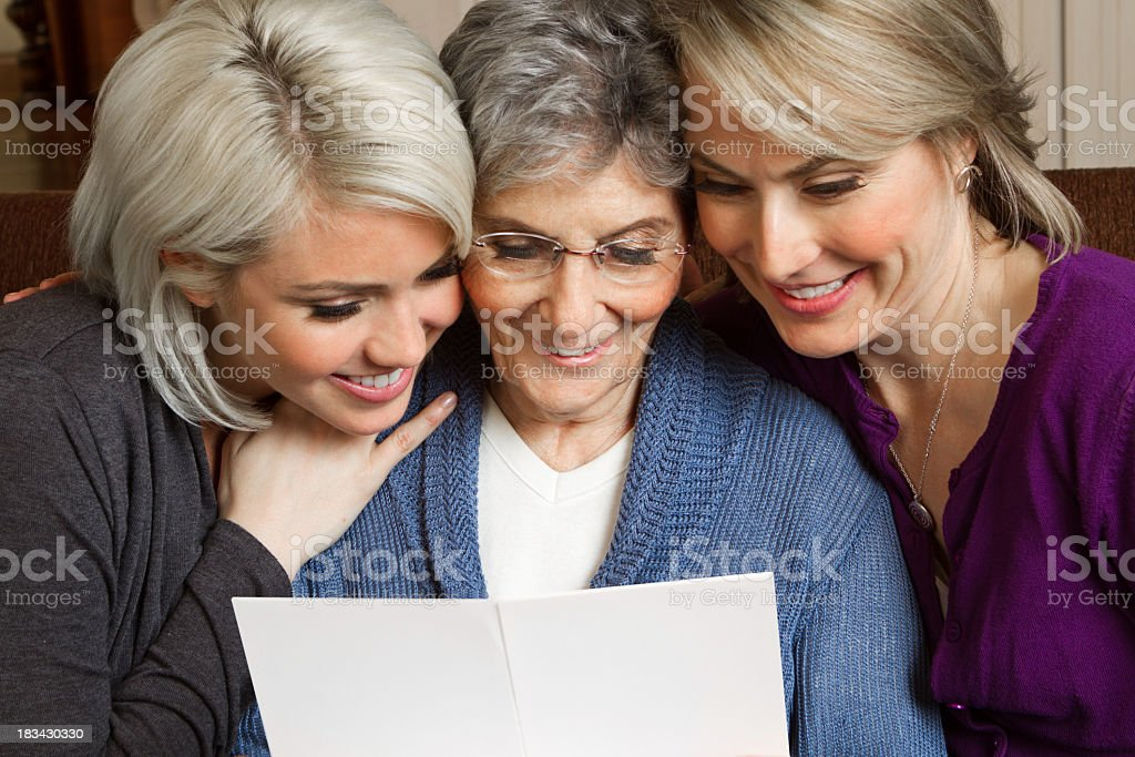 Woman reading a greeting card royalty-free stock photo