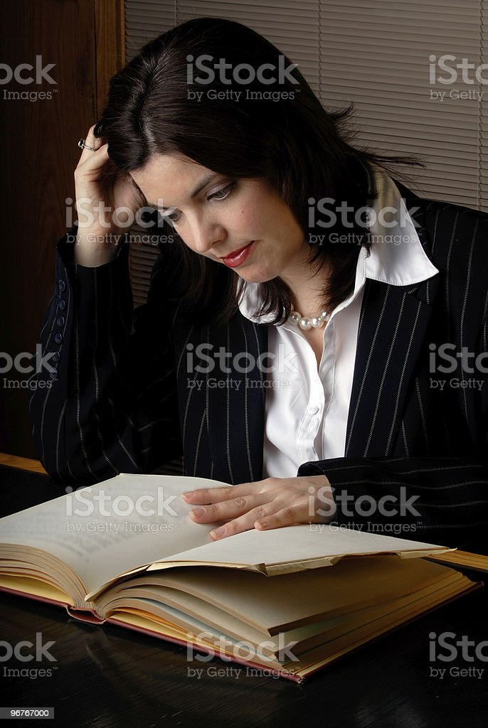 Woman Reading A Law Book stock photo