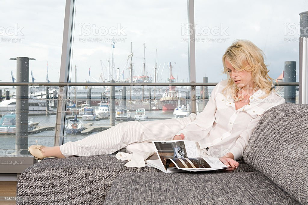 Woman reading a magazine royalty-free stock photo