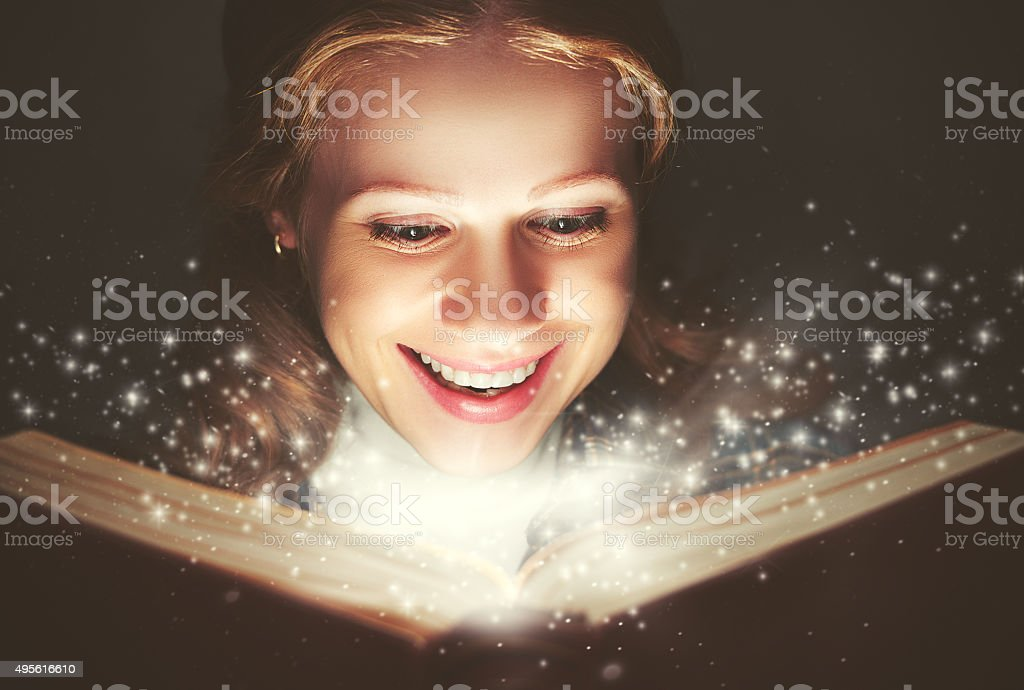 woman reading a magic book stock photo