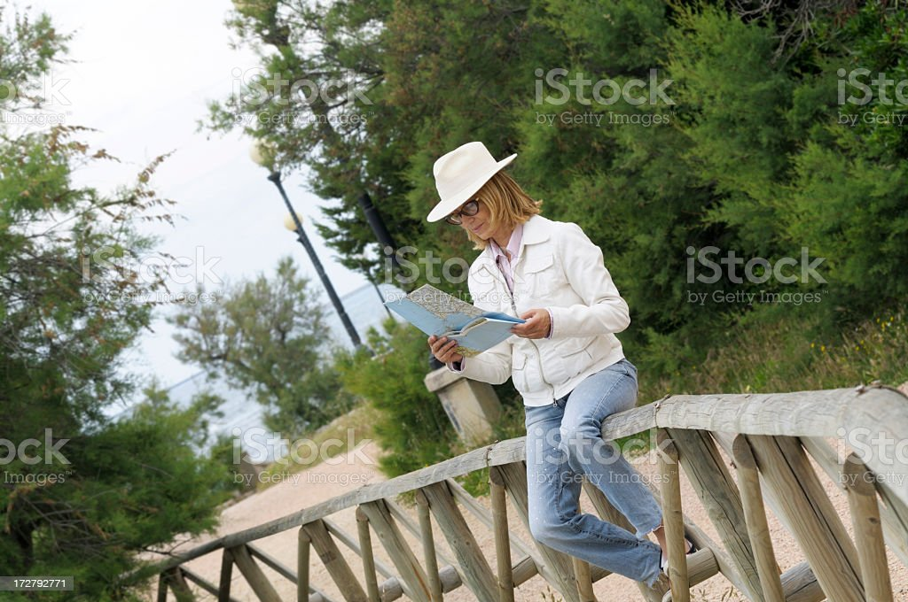 Woman reading a road map royalty-free stock photo