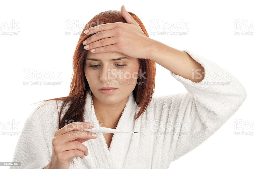 Woman reading a thermometer royalty-free stock photo