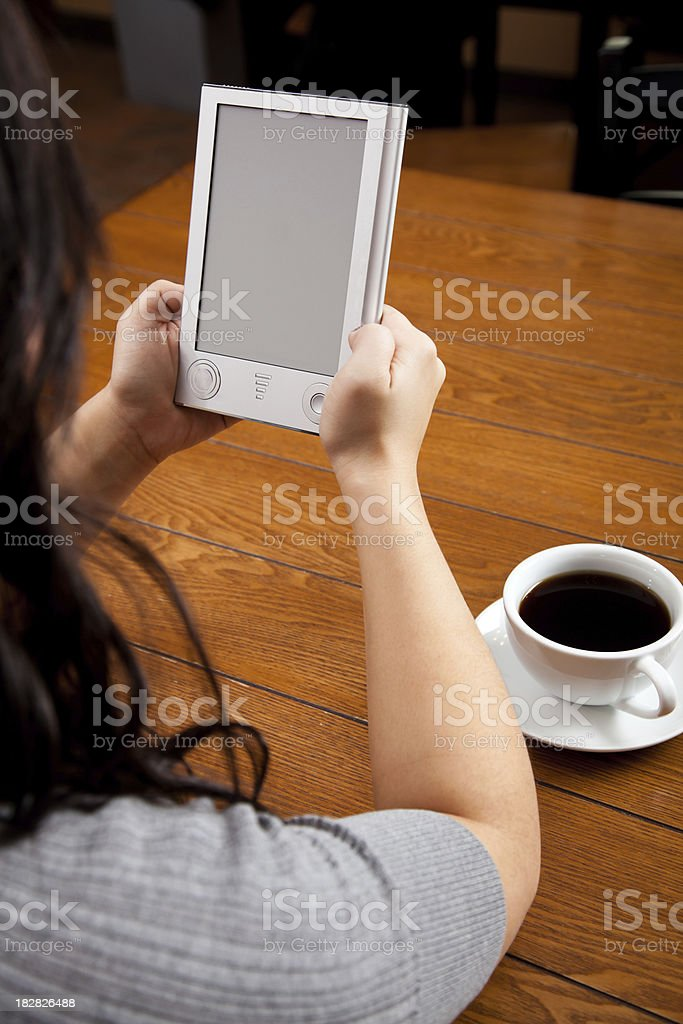 Woman Reading an eBook royalty-free stock photo