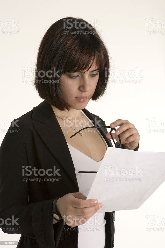 Woman reading and holding glasses royalty-free stock photo