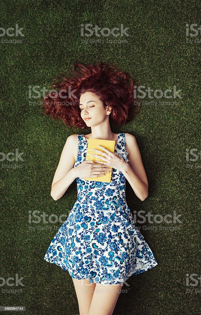 Woman reading at the park stock photo