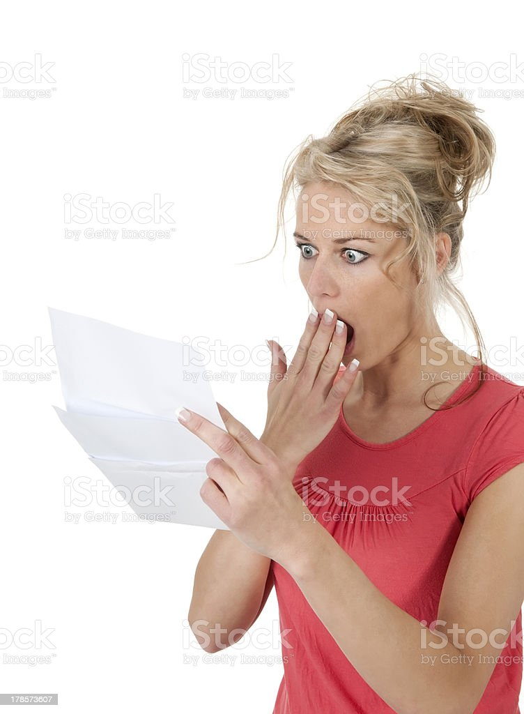 woman reading bad news stock photo