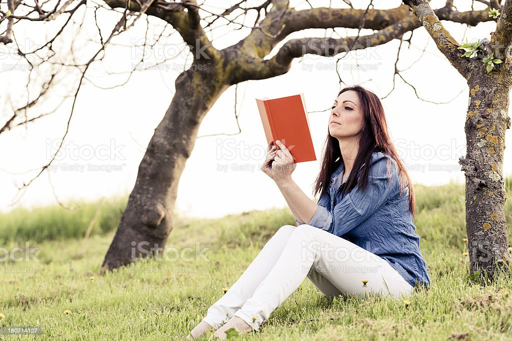 Woman reading book in a Park royalty-free stock photo