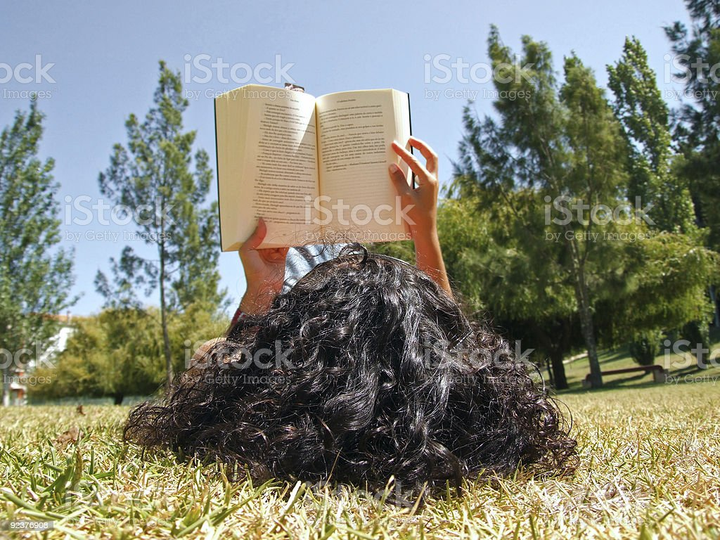Woman reading book in park royalty-free stock photo