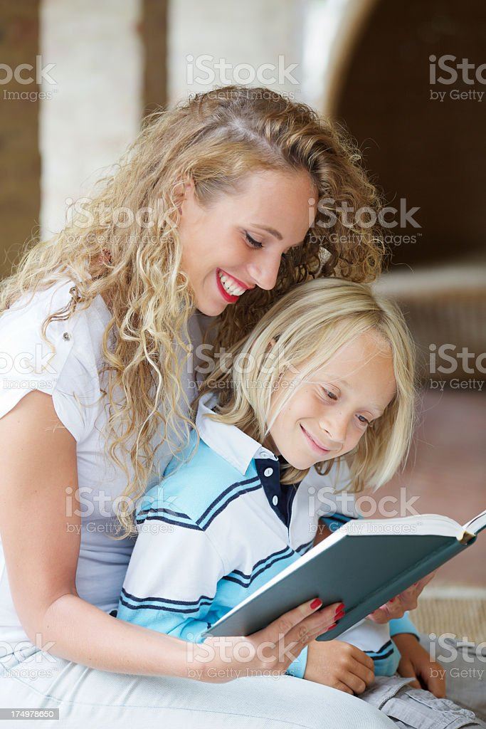 Woman reading book to little boy royalty-free stock photo
