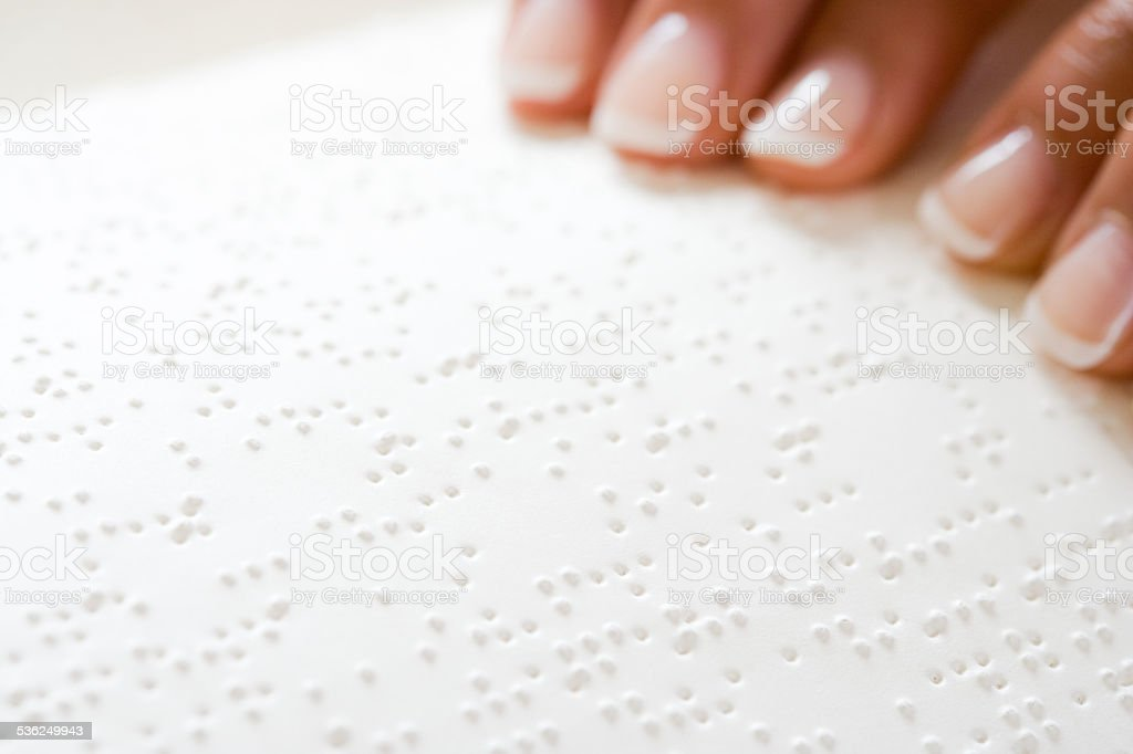 Woman reading braille stock photo
