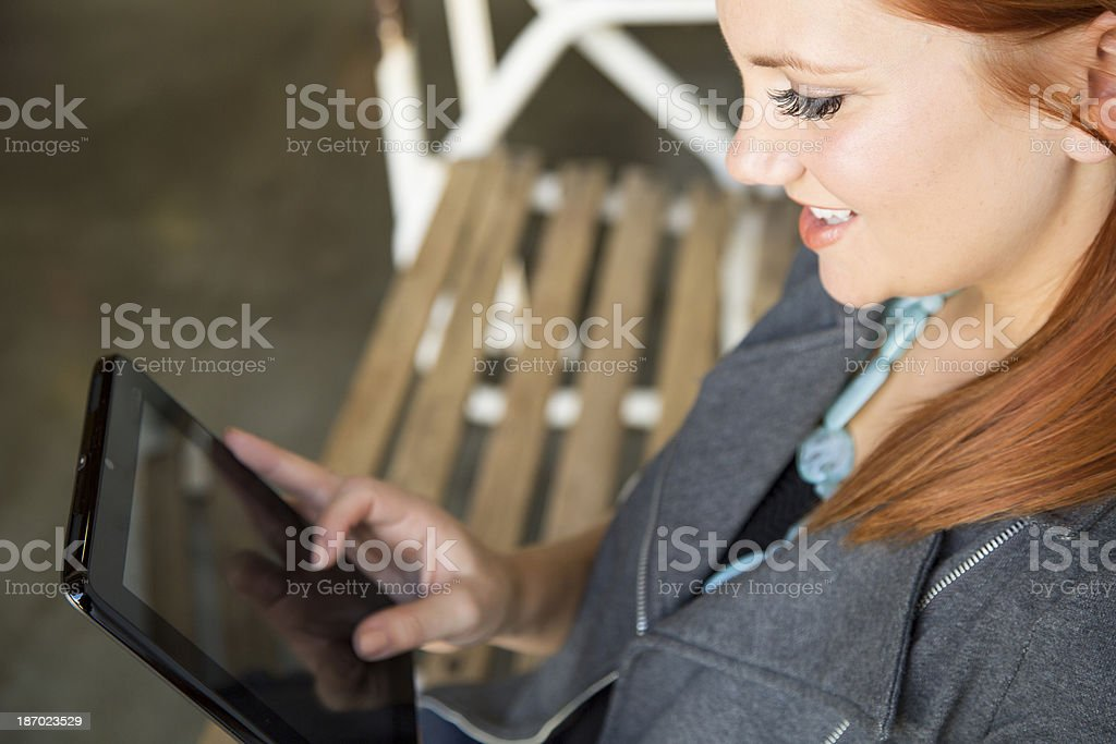 Woman Reading Ebook on Tablet royalty-free stock photo