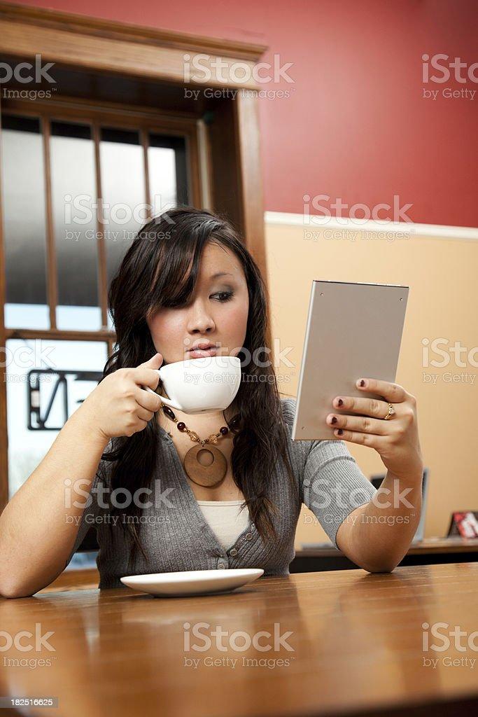 Woman Reading eBook stock photo