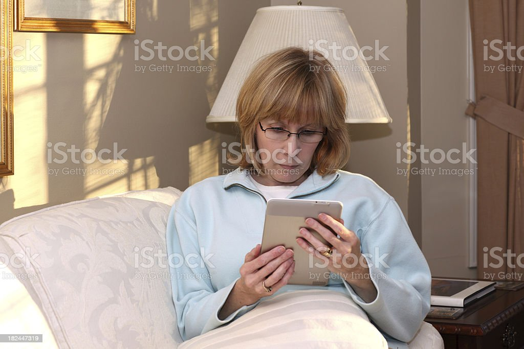 Woman Reading Electronic Book stock photo
