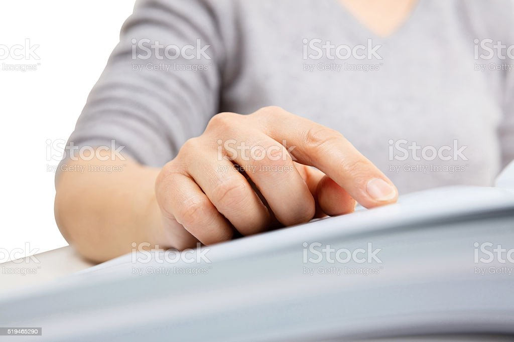 Woman reading, Finger showing text in a book stock photo