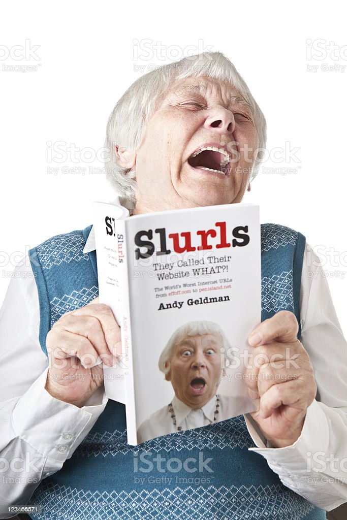 Woman reading funny book with herself on front cover stock photo