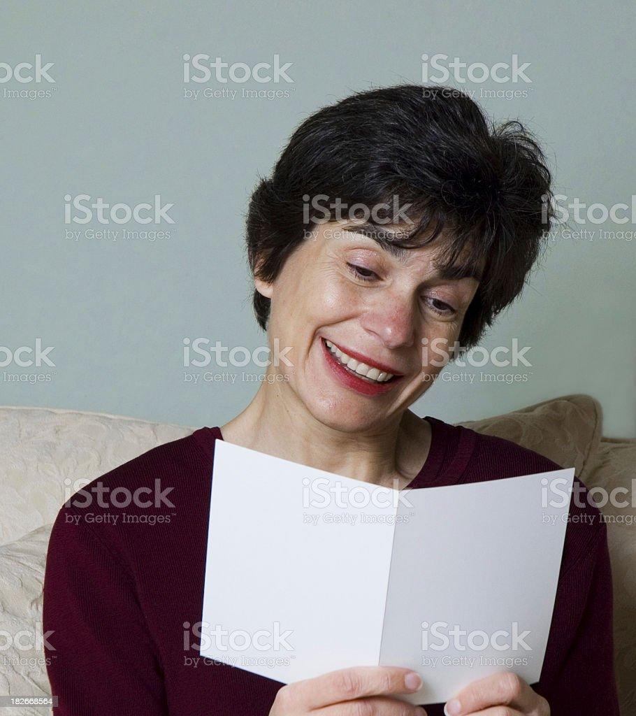 Woman reading greeting card royalty-free stock photo