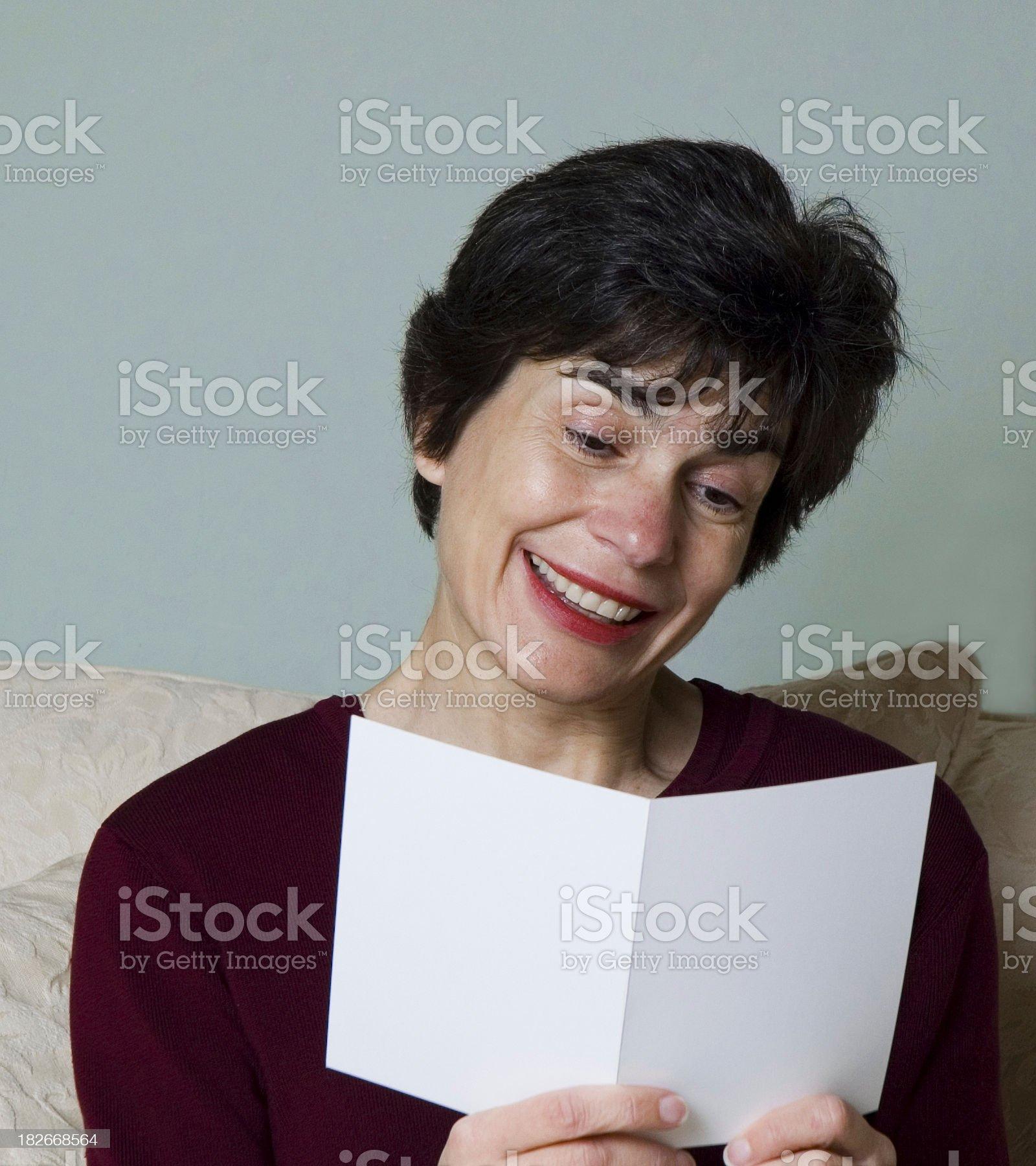Woman reading greeting card royalty-free stock photo