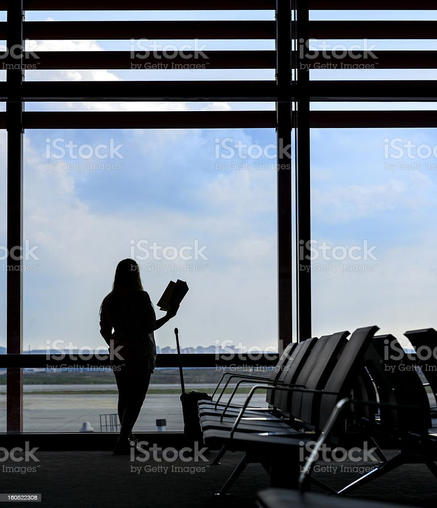 woman reading in airport royalty-free stock photo