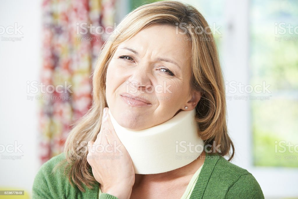 Woman Reading Letter After Receiving Neck Injury stock photo