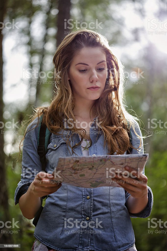 Woman Reading Map In Forest royalty-free stock photo