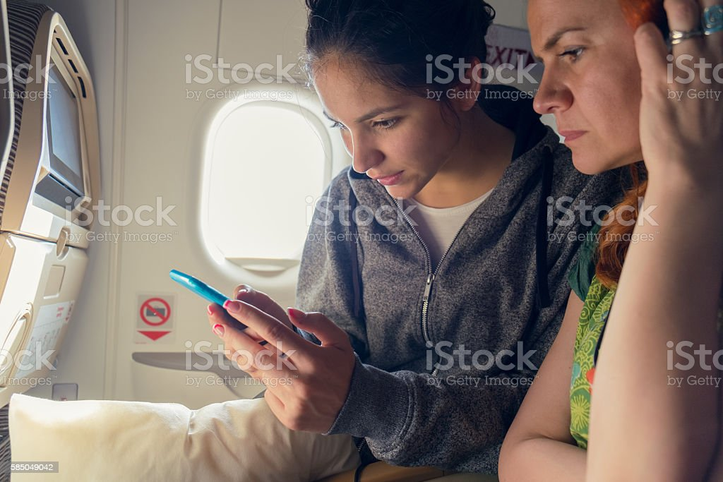 Woman reading news in plane stock photo