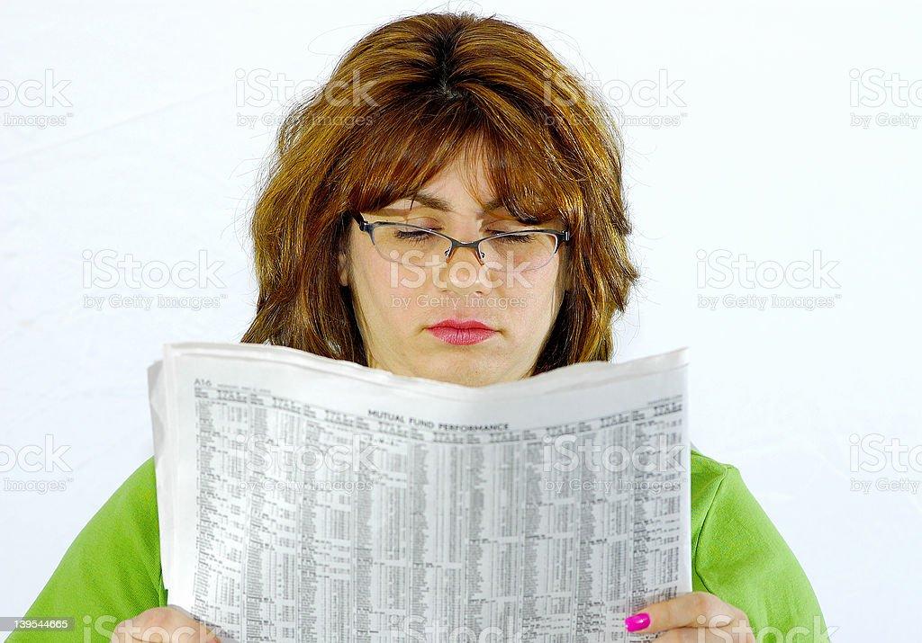 Woman Reading Newspaper royalty-free stock photo